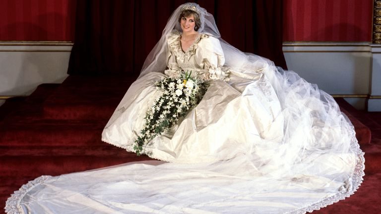 File photo dated 29/07/81 of the Princess of Wales seated in her bridal gown at Buckingham Palace after her marriage to Prince Charles at St. Paul's Cathedral. Diana, Princess of Wales's famous wedding dress is set to go on show at Kensington Palace for the first time in 25 years. Issue date: Monday April 26, 2021.