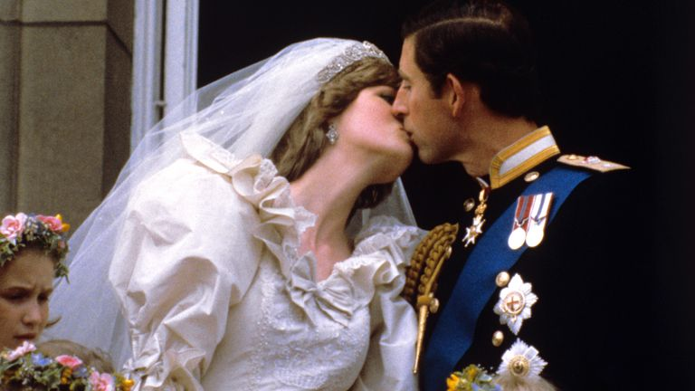 File photo dated 29/07/81 of the newly married Prince and Princess of Wales kissing on the balcony of Buckingham Palace after their wedding ceremony at St. Paul's cathedral. Diana, Princess of Wales's famous wedding dress is set to go on show at Kensington Palace for the first time in 25 years. Issue date: Monday April 26, 2021.