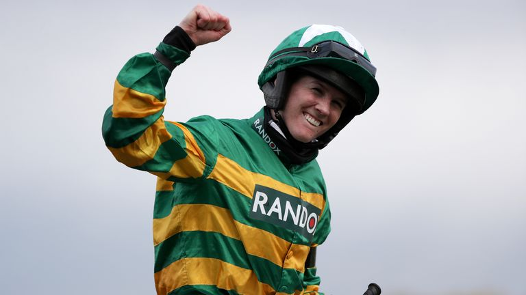 Rachael Blackmore ridding Minella Times celebrates after winning the Randox Grand National Handicap Chase on the third day of the Grand National Horse Racing meeting at Aintree racecourse, near Liverpool, England, Saturday April 10, 2021. (AP Photo/Scott Heppell, Pool)