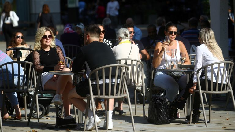 People pictured sitting outside at a restaurant in Chelsea, London. File pic