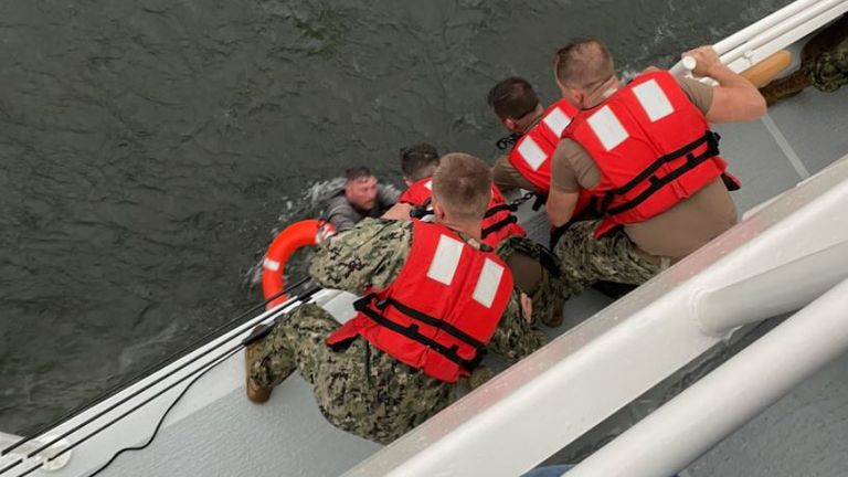 A member of the crew of the Seacor Power is pulled from the sea