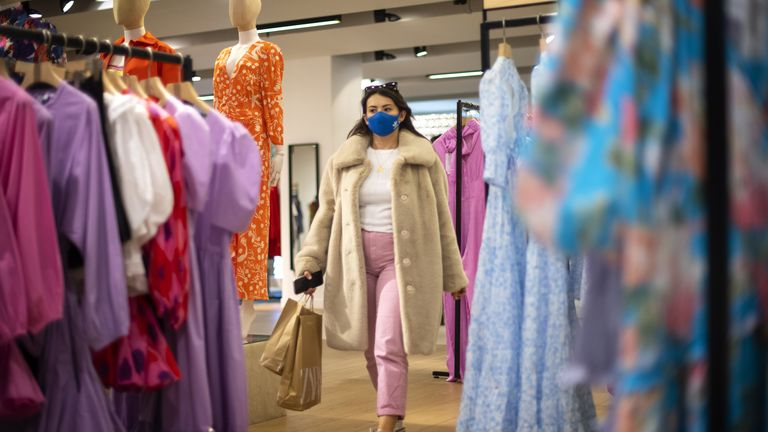 A shopper walks through the store during the reopening of the Selfridges on Oxford Street, London, as England takes another step back towards normality with the further easing of lockdown restrictions. Picture date: Monday April 12, 2021.