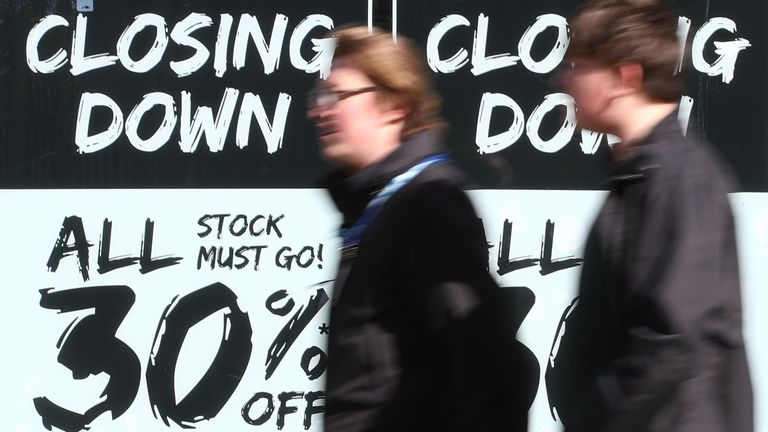 Shoppers walk past closing down discount signs in Nottingham as England takes another step back towards normality with the further easing of lockdown restrictions. Picture date: Monday April 12, 2021.