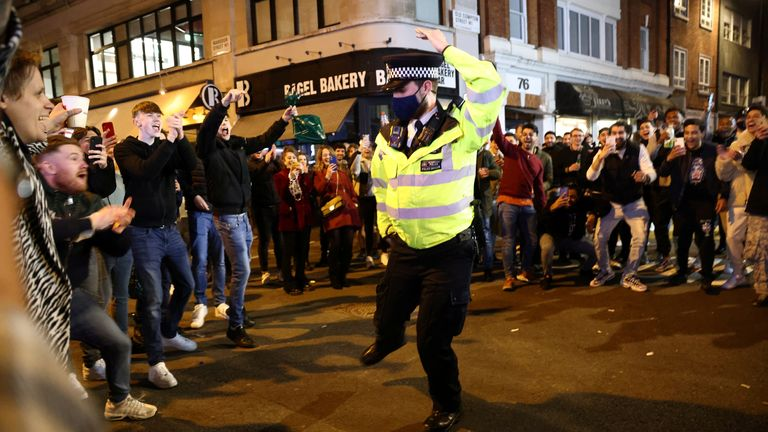 Policemen were among those dancing on the streets of Soho