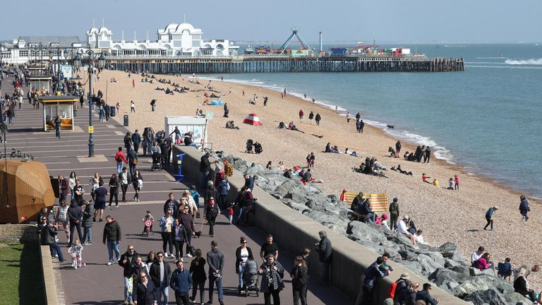 People enjoy a sunny afternoon in Southsea, Hampshire, on Easter Sunday