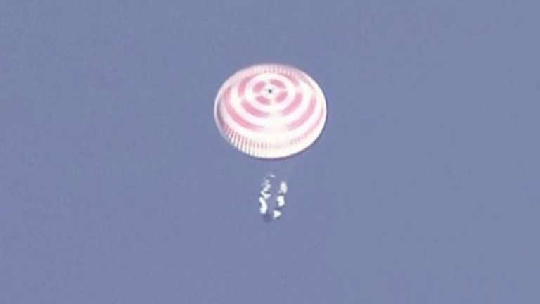 Capsule carrying three members of ISS crew returns to earth