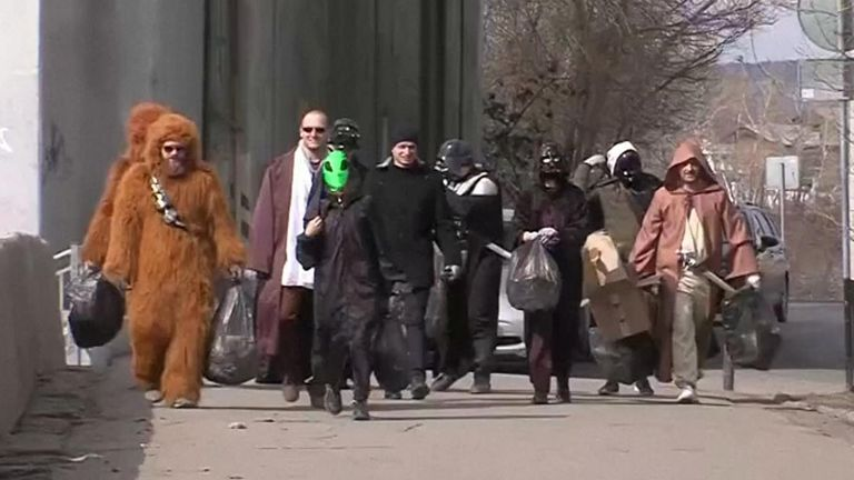 People dressed as characters from Star Wars cleaned streets to mark the 60th anniversary of the first human space flight.