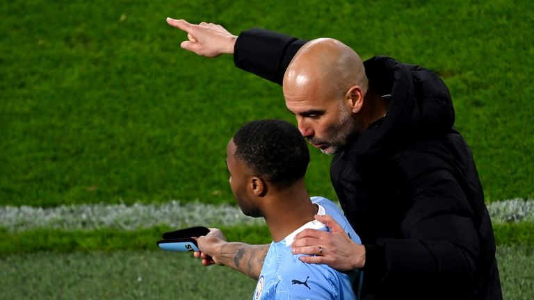 "14 April 2021, North Rhine-Westphalia, Dortmund: Football: Champions League, knockout round, quarter-finals, second leg, Borussia Dortmund - Manchester City at Signal Iduna Park. Manchester coach Josep ""Pep"" Guardiola talks to his player Raheem Sterling before his substitution. Photo by: Federico Gambarini/picture-alliance/dpa/AP Images"