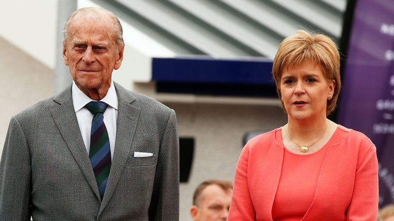 Britain's Queen Elizabeth stands with Prince Philip and Scotland's First Minister Nicola Sturgeon as she officially opens the Scottish Borders Railway at Tweedbank Station in Scotland, Britain September 9, 2015. Queen Elizabeth who ascended the throne aged just 25 as her exhausted country struggled to recover from the ravages of World War Two, made history on Wednesday when she became Britain's longest-reigning monarch. REUTERS/Phil Noble