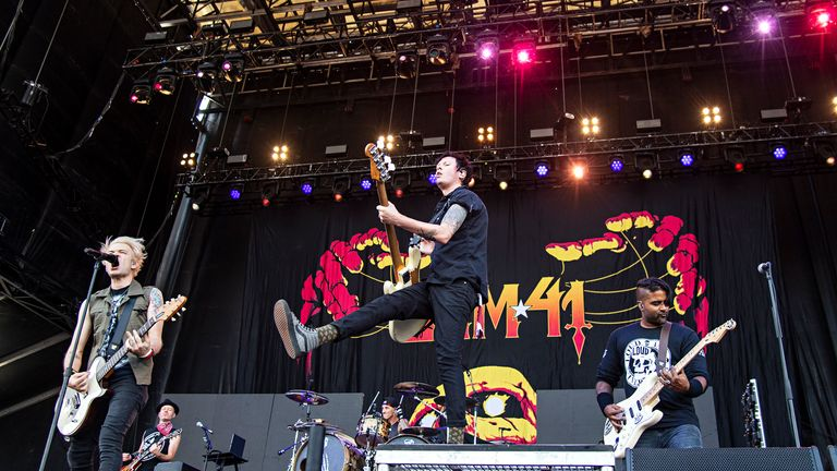 Deryck Whibley, from left, Jason McCaslin, and Dave Baksh of Sum 41 perform during Louder Than Life at Highland Festival Grounds at KY Expo Center on Sunday, Sept. 29, 2019, in Louisville, Ky. (Photo by Amy Harris/Invision/AP)