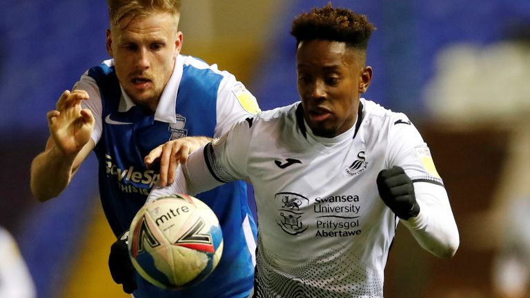 Swansea's Jamal Lowe (L) in action against Birmingham City, after which he suffered abuse