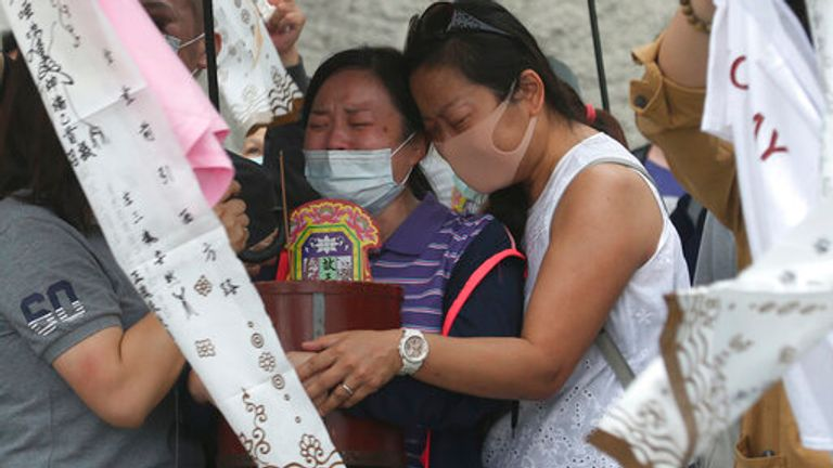The families of the victims were seen grieving on Saturday by the crash site