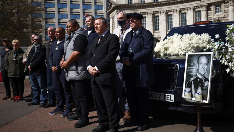 London Black Cab taxi drivers observe a minute's silence during the funeral of Britain's Prince Philip, husband of Queen Elizabeth, who died at the age of 99, on The Mall in London, Britain, April 17, 2021. REUTERS/Henry Nicholls