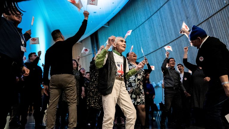 A voter in Greenland dances after the election.