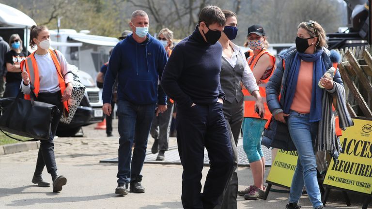 Tom Cruise walking on set