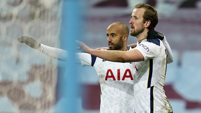 Harry Kane is pictured with Lucas Moura (left)