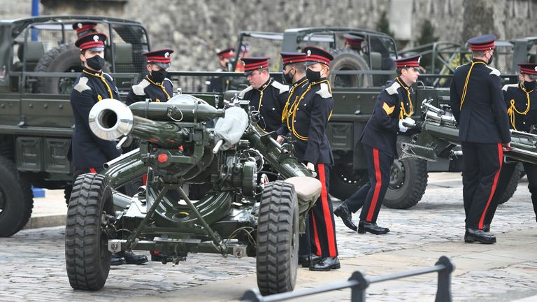Members of the Honourable Artillery Company prepare to fire a 41-round gun salute at the Tower of London