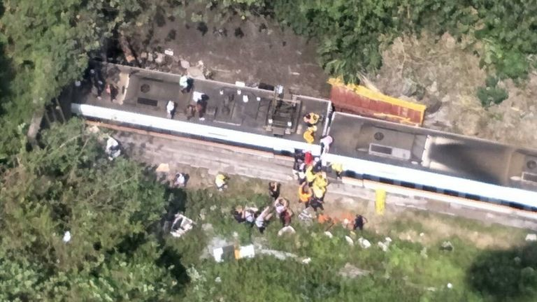 Overhead images showed rescue workers helping passengers out of the derailed train