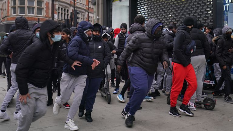 Early morning shoppers gather outside the JD Sports store in Oxford Street, London, waiting for the store to reopen as England takes another step back towards normality with the further easing of lockdown restrictions. Picture date: Monday April 12, 2021.
