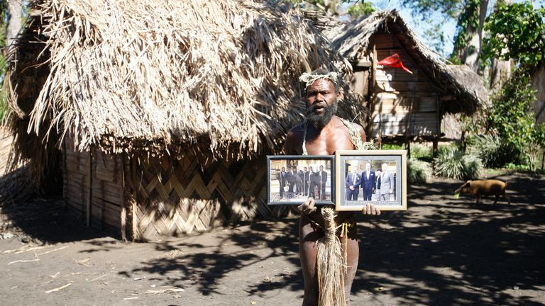 A tribesman named Albi Nagia posed with photographs of Prince Philip in 2015 ancestral God. (AP Photo/Nick Perry)