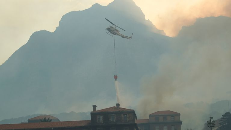 A wildfire on the slopes of South Africa's Table Mountain forced University of Cape Town students to evacuate,