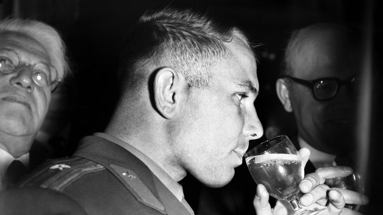 FILE - In this Thursday, July 13, 1961 file photo, Yuri Gagarin, the Soviet cosmonaut, sips a cool drink at a reception in his honor at Hyde Park Hotel, London. The successful one-orbit flight on April 12, 1961 made the 27-year-old Gagarin a national hero and cemented Soviet supremacy in space until the United States put a man on the moon more than eight years later. (AP Photo/Bob Dear, File)