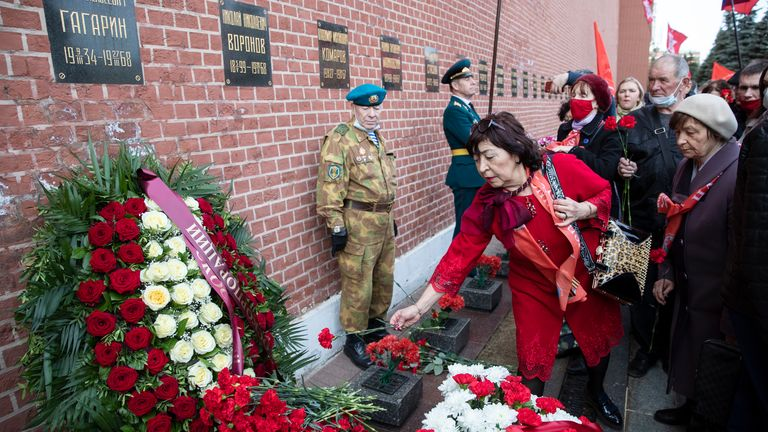 Russian's lay flowers at his grave