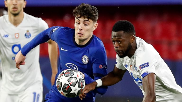 Porto's Chancel Mbemba, right, duels for the ball with Chelsea's Kai Havertz during the Champions League quarter final second leg soccer match between Chelsea and Porto at the Ramon Sanchez Pizjuan stadium, in Seville, Spain, Tuesday, April 13, 2021. (AP Photo/Angel Fernandez)