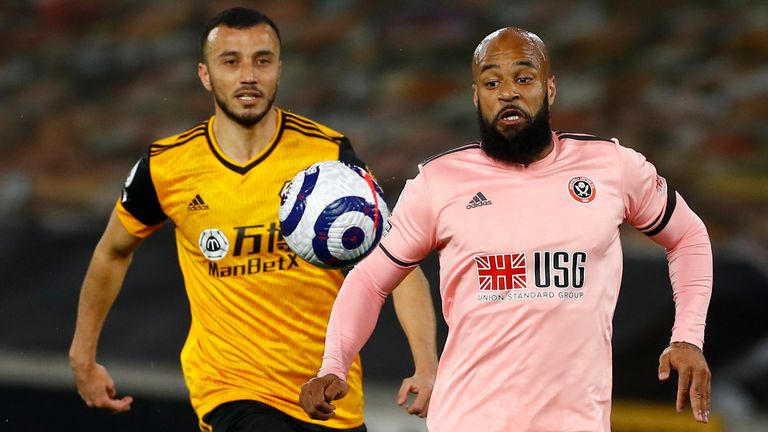 David McGoldrick and Romain Saiss in Premier League action at Molineux (AP)