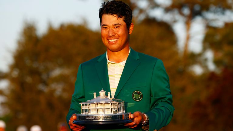 Hideki Matsuyama holds the Masters trophy during the Green Jacket ceremony after his one-shot win at Augusta