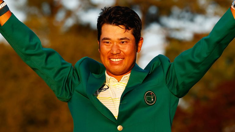 Hideki Matsuyama celebrates after winning the Masters