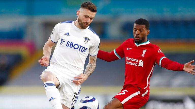 Leeds United's Stuart Dallas, left, is challenged by Liverpool's Georginio Wijnaldum