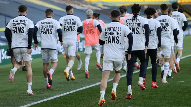 Leeds players warm up in t-shirts stating 'football is for the fans' ahead of Monday's clash with Liverpool