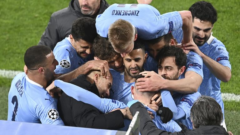 Manchester City manager Pep Guardiola celebrates with goal scorer Phil Foden and team-mates after their second goal during the UEFA Champions League, quarter final, second leg match at Signal Iduna Park in Dortmund