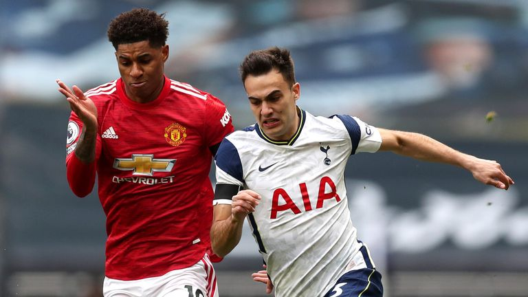 Marcus Rashford and Sergio Reguilon compete for possession