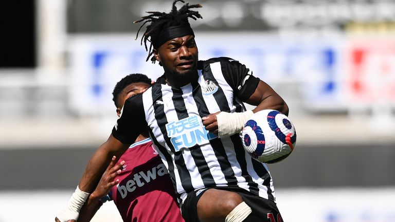Newcastle...s Allan Saint-Maximin kicks the ball away from West Ham's Ben Johnson, left, during the English Premier League soccer match between Newcastle United and West Ham United at St James' Park, Newcastle, England, Saturday April 17, 2021. (AP Photo/Stu Forster/Pool)..