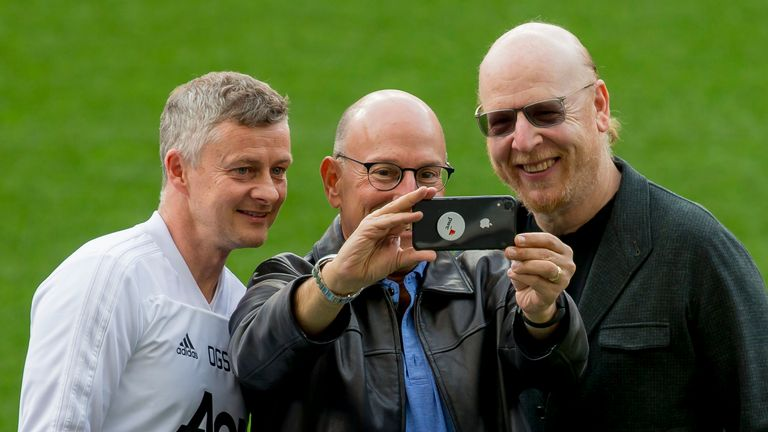 Ole Gunnar Solskjaer with Manchester United club owners Joel and Avram Glazer