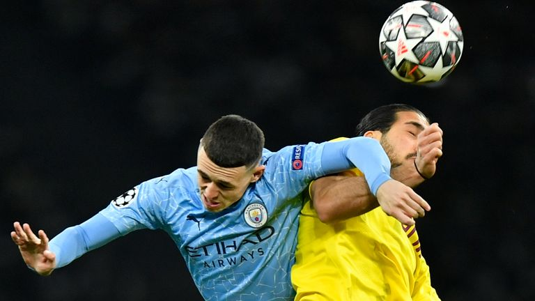Phil Foden and Emre Can compete for the ball during the Champions League quarter-final second leg