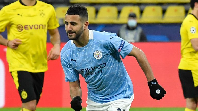 Manchester City's Riyad Mahrez celebrates after scoring his side's first goal during the Champions League quarterfinal second leg soccer match between Borussia Dortmund and Manchester City at the Signal Iduna Park stadium in Dortmund