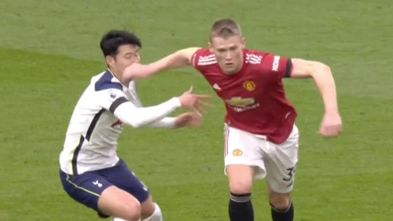 Scott McTominay was penalised for this stray arm on Heung-min Son in the build-up to Edinson Cavani's goal