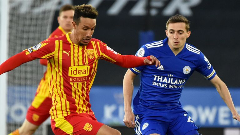 West Brom's Callum Robinson battles for possession with Timothy Castagne of Leicester