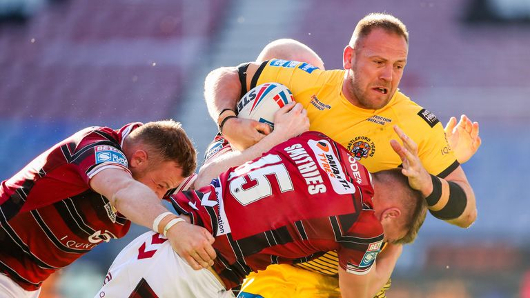 Wigan Warriors beat Castleford Tigers 22-12 on their return to the DW Stadium to remain unbeaten in Super League