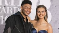 Perrie Edwards and her partner Alex Oxlade-Chamberlain have announced they are expecting their first child. Pic: Vianney Le Caer/Invision/AP