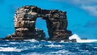 This photo distributed by Galapagos National Park shows Darwin's Arch off the Galapagos Islands, Ecuador, Sunday, May 16, 2021. Ecuador's Environment Ministry reported the collapse of the top of the arch on its Facebook page on Monday, May 17, and blame natural erosion of the stone. (Galapagos National Park via AP)