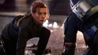"""This image released by Disney shows Scarlett Johansson in a scene from """"Black Widow."""" (Jay Maidment/Disney-Marvel via AP)"""