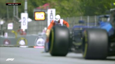 Marshal sprints onto track to remove debris!