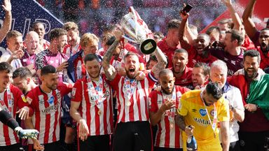Brentford hold the play-off trophy aloft!