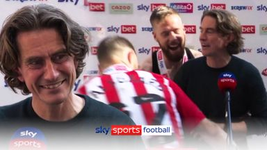 Frank carried off by players during interview!