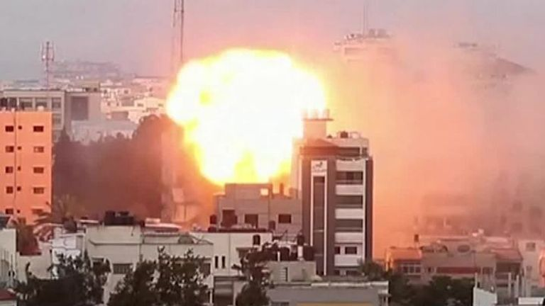 Buildings collapse after continued bombardment by Israeli air strikes in Gaza City.