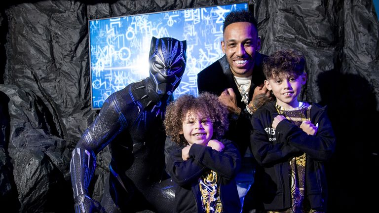 Pierre-Emerick Aubameyang, with his sons Pierre and Curtys, unveiling the new Black Panther wax figure at Madame Tussauds in central London. Picture date: Thursday May 13, 2021.